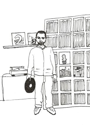 David Krieger vor seinem Plattenregal